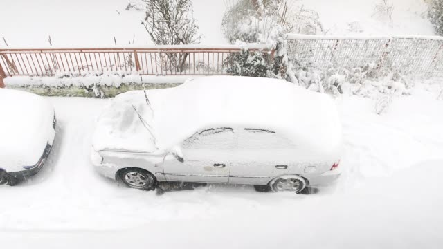 Two cars covered with snow during the snowstorm video