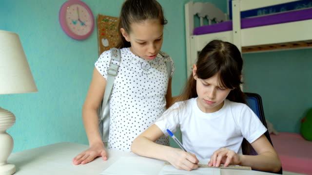 two caucasian girls doing homework video