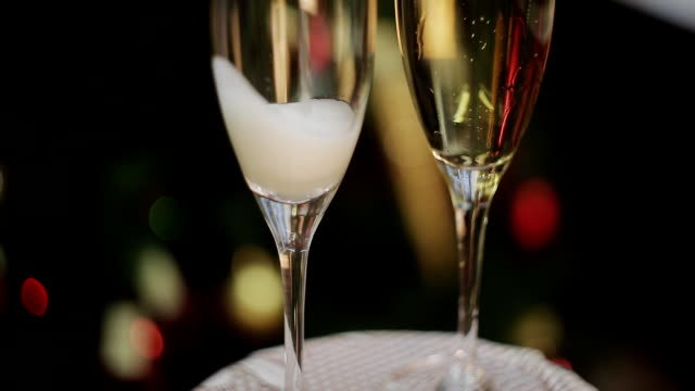 Two Champagne Glasses On Defocused Background Living Room With Christmas Tree video