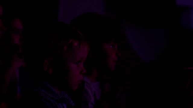 Two children in the auditorium looking at stage. video