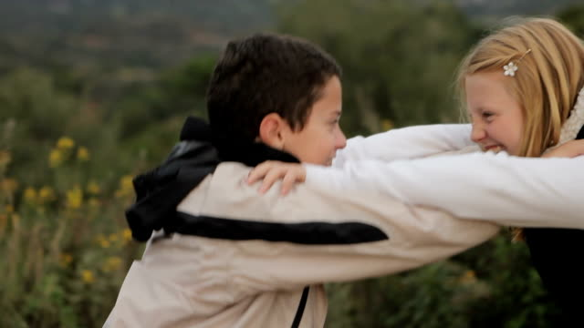 two children play fighting. - wrestling stock videos and b-roll footage