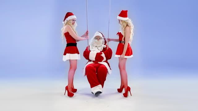 Two Christmas girls swings Santa Claus video
