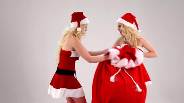 Two Christmas woman struggle for gift sack video