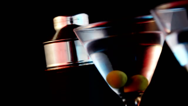 Two cocktail glasses with green olives video