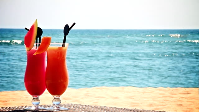 two cocktails on the beach - alcohol stock videos and b-roll footage