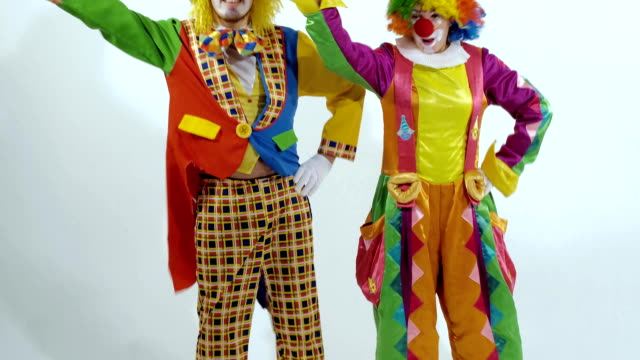 Two comic circus clowns dancing synchronously video