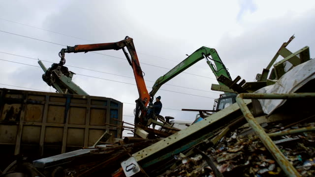 Two Cranes with Mechanical Claw Moves Metal Scrap video