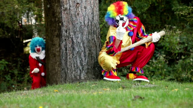 Two Creepy Clowns Hiding In Woods video