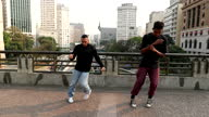 istock Two dancers dancing in urban downtown city 1278398498