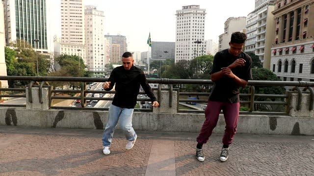 Two dancers dancing in urban downtown city