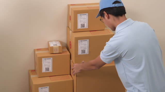 Two Delivery worker lifting box and check order