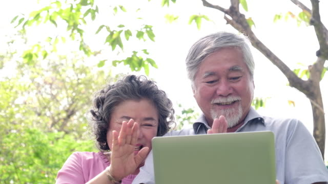 Two elderly person using new technology live video call with laptop computer and talking. video