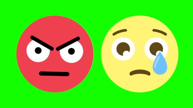 zwei emoticons für verrückt und traurige gefühle - emojis stock-videos und b-roll-filmmaterial