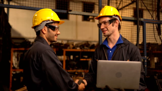 Two engineering in production plant as team discussing Two engineering in production plant as team discussing in factory manufacturing equipment stock videos & royalty-free footage