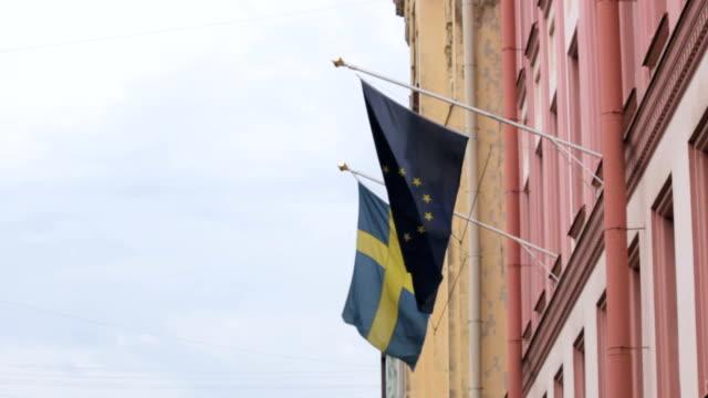 två europeiska flaggor på byggnaden av sveriges generalkonsulat, st. petersburg - sweden map bildbanksvideor och videomaterial från bakom kulisserna