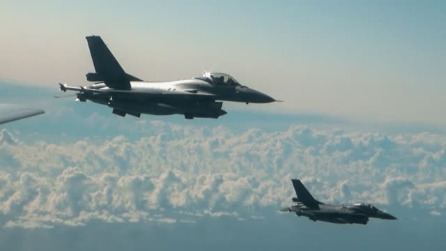 Two f-16 fighters in the air