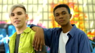 istock Two fashionable teenagers looking camera, urban fashion trends, young people 1174532774
