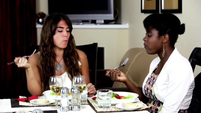 Two female friends enjoying lunch. video
