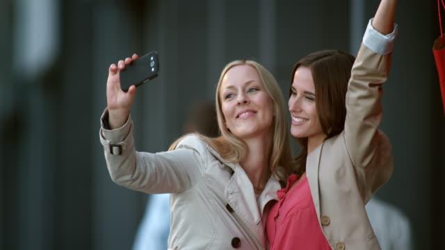 SLO MO two female friends making shopping selfies