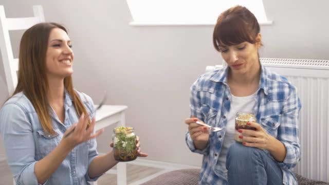 Two female friends on casual lunch break video