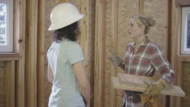 Two Female Home Builders Chatting on the Job Site video