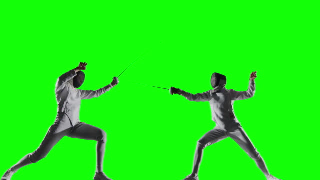 Two fencing sportswomen in action on green background video