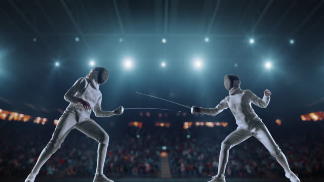 Two fencing sportswomen on professional arena video