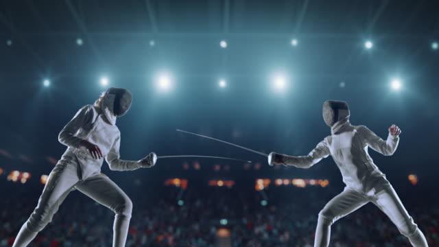 two fencing sportswomen on professional arena - lottare video stock e b–roll