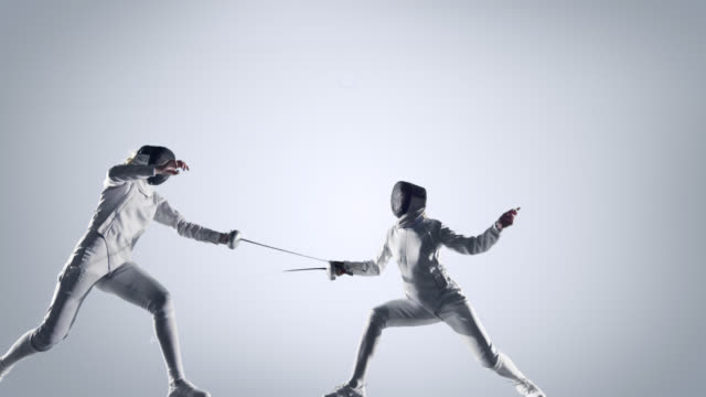 Two fencing sportswomen on white background video