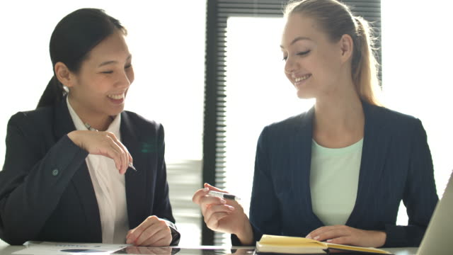 Two Financial workers discussing future development plans on Digital tablet in office