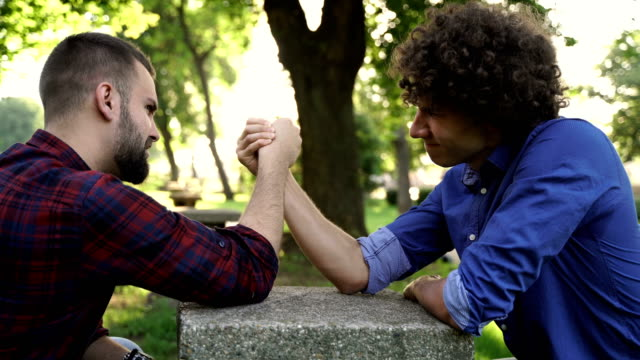 Two friends arm wrestling Two friends arm wrestling shivering stock videos & royalty-free footage