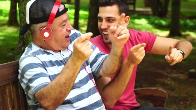 Two Friends/ Father and Son Dancing, Listening Music and Having Fun Two Friends/ Father and Son Dancing, Listening Music and Having Fun latin american and hispanic ethnicity stock videos & royalty-free footage