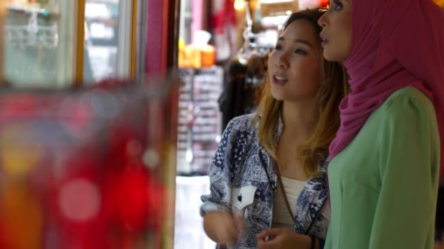 two friends having shopping at the bazaar - malese video stock e b–roll