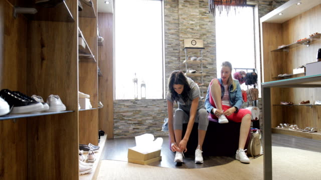two friends trying on shoes - shoes fashion stock videos and b-roll footage