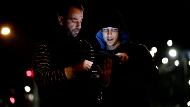 Two friends using tablet video