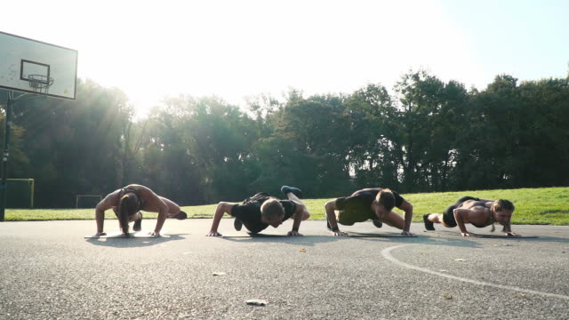 two girls and two boys doing alligator push ups