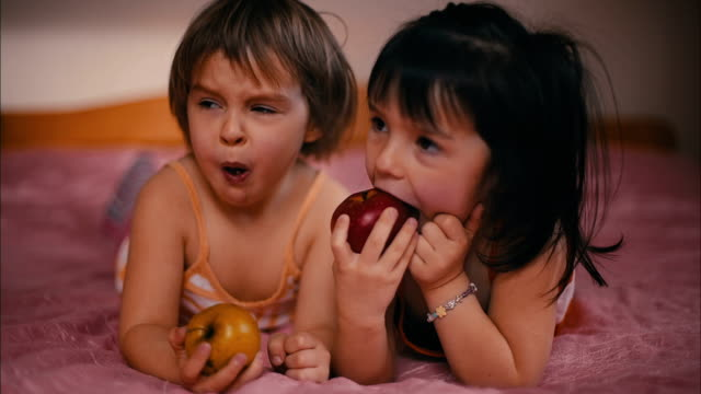 Two Girls are Eating an Apple video