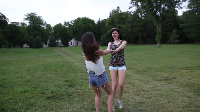two girls having fun in the park,