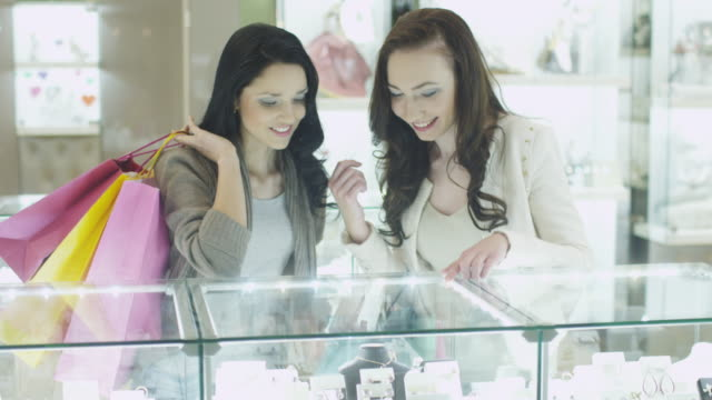 Two Girls in Jewellery Store are Watching at Display Windows video