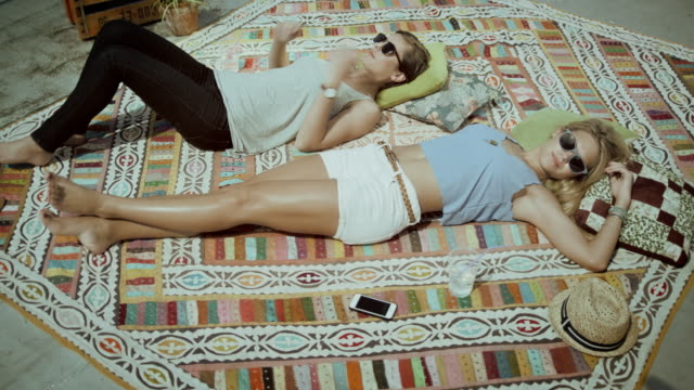 Two girls lying on carpet Selected Takes - Shot on RED Epic sunbathing stock videos & royalty-free footage