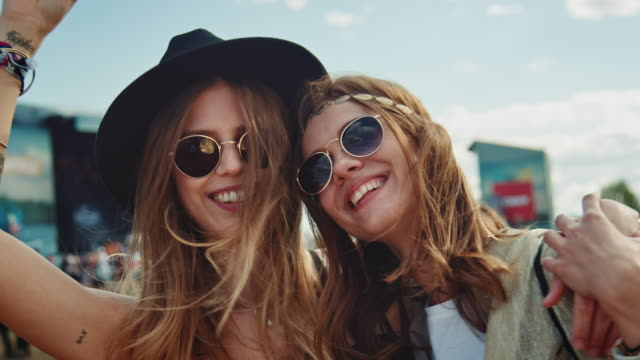 Two girls on festival Two girls are together on a music festival. They having a wonderful time.   carnival celebration event stock videos & royalty-free footage
