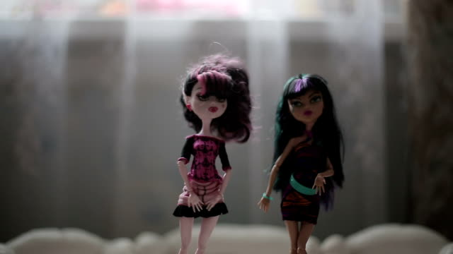 Two girls play with dolls. Macro lens for dolls video