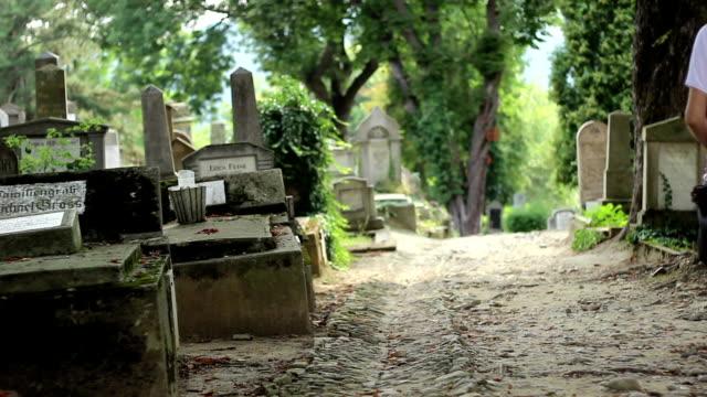 Two Girls Walking in Cemetery video