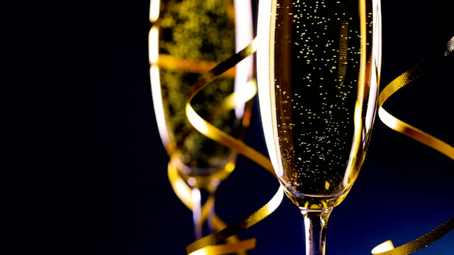 vídeos de stock e filmes b-roll de two glasses of champagne - happy new year