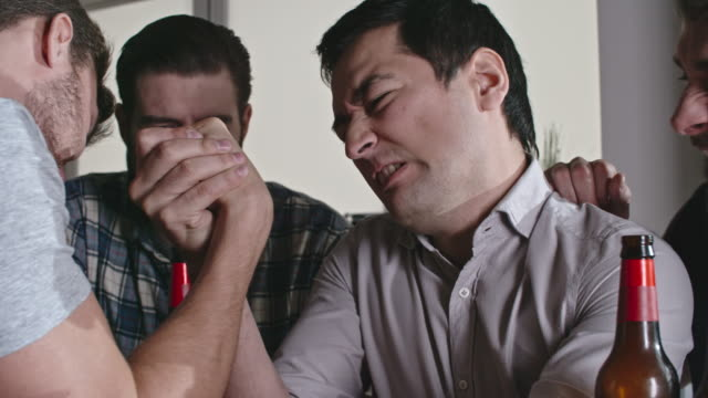 two guys arm wrestling at party - bachelor party stock videos and b-roll footage