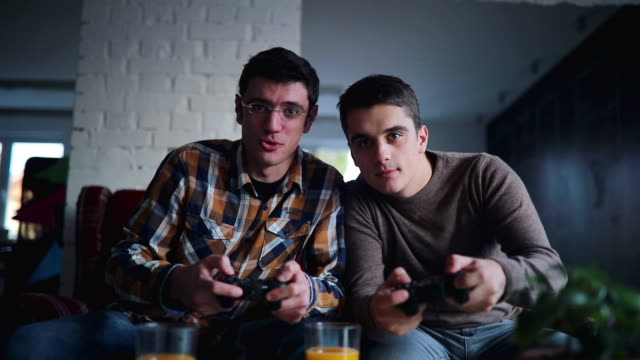 Two guys playing video games in office video