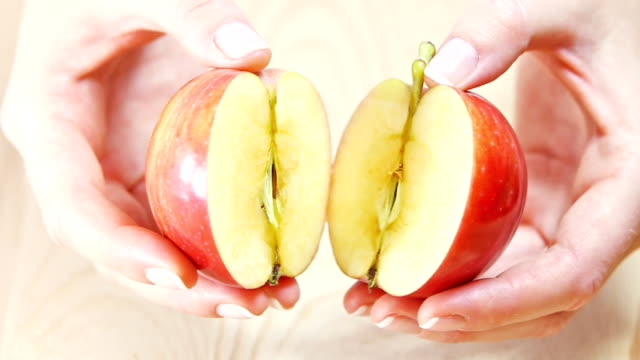 Two halves of an apple. video