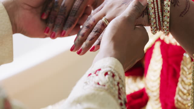Two hands, one heart 4k video footage of an unrecognizable young couple on their wedding day sari stock videos & royalty-free footage