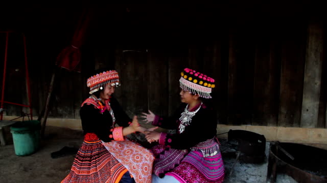 Two hill tribe playing together at her house video