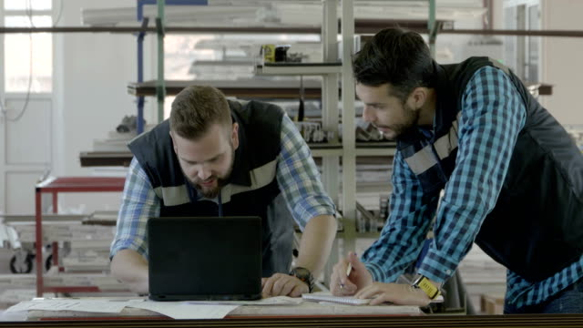 Two industrial engineers with laptop Two industrial engineers with laptop production line worker stock videos & royalty-free footage